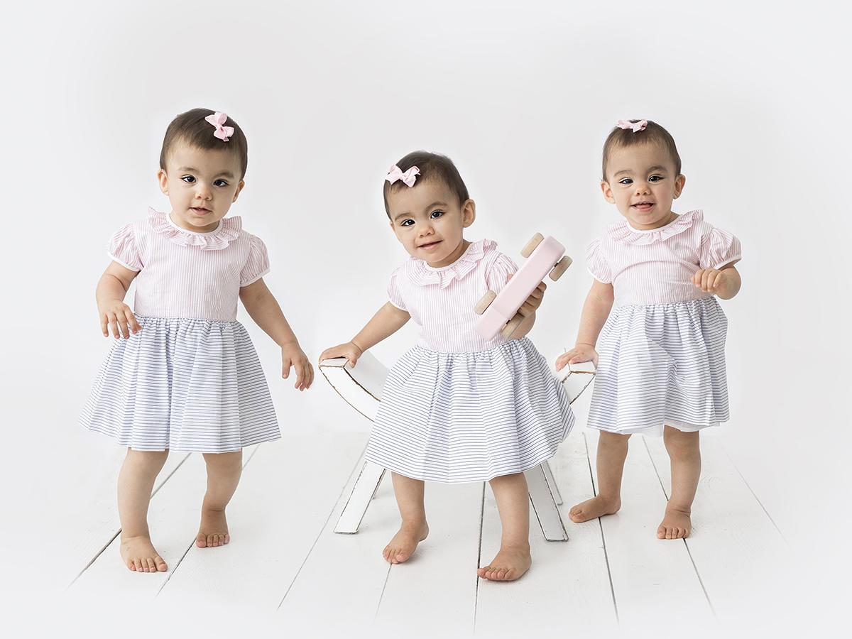 enäggstvillingar på 1årsfotografering i studio
